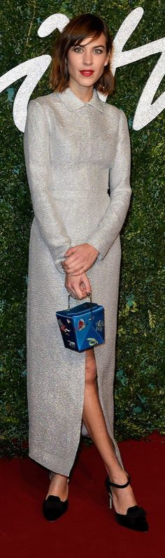 Alexa Chung showed a little leg in a slit gown at the British Fashion Awards