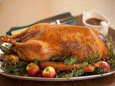 Roast Goose and Stuffing:  8 to 10 servings. 50 prunes  Earl Grey tea  1/4 pint (1/2 cup) dry vermouth  3/4 pint (1 1/2 cups) goose stock (made from the neck and giblets)  1 ounce butter  4 shallots, finely chopped  Goose liver, blanched and finely chopped  1/4 pint (1/2 cup) port  4 ounces pate de foie gras (or similar)  3 tablespoons fresh bread crumbs  Pinch ground allspice and dried thyme  Salt and freshly ground black pepper  1 (10 pound) oven-ready goose  Make sure you have a…