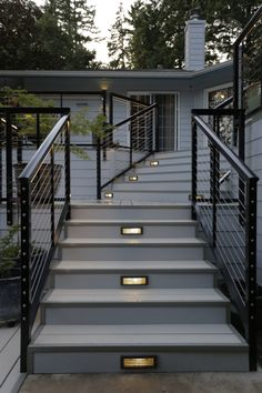 Modern Aluminum Tri-level Deck Design and Build - G. Christianson Construction Karen and Mike also chose a Stainless Steel Cable Railing system and Nexan's Black powder coated posts to support the steel cables. Outdoor Stair Railing, Deck Railing Design, Modern Railing, Modern Deck, Deck Stairs, Balcony Railing, Deck Railings, Deck Design, Railing Ideas