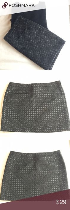 NWT Gap Winter Mini Skirt NWT Winter Mini Skirt from Gap. Pretty; black with silver accents. Heavyweight cloth, fully-lined for winter. Perfect with tights, sweater, and boots. GAP Skirts Mini