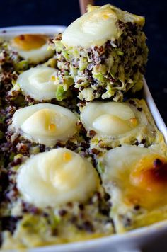 Cheesy Zucchini Quinoa Casserole is a perfect healthy side dish that can make anyone love this amazingly healthy seed. This can be served in square slices.