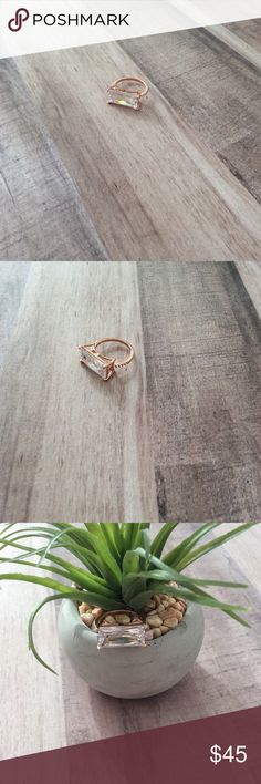 12CT Emerald Cut 14k Rose Gold 🌹 Statement Ring Bling bling statement ring Gorgeous 12CT emerald Cut CZ stone set in a 14k rose gold plated setting. Pave clear cz stones flank both sides. Size 6. Very beautiful. Buy yourself a little treat for Valentine's Day! Brand new with box! Jewelry Rings