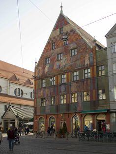 Weberhaus, a colorful, 6 story medieval building on  Maximillian Strasse, St. Moritzplatz, Innerstadt Augsburg, Germany ~ (St. Moritz Church, along side)
