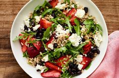 Arugula Salad With Black Beans, Barley, Strawberry, and Feta Recipe | SELF