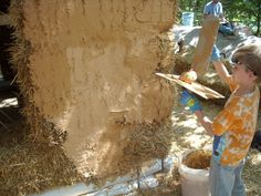 A straw bale home gets the clay coating for the outside.  These homes are virtually fireproof, as the straw is compressed so tightly that there is no air to fuel a fire.
