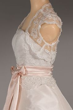 Amoret's quarter-scale wedding dress  http://www.thelittlecostumeshop.com/weddings/dress-001.html