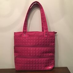 """Lug, Taxi- Full Tote Bag NWOT.  Pink Lug Life Bag!  Measurements are 16.5""""w x 13"""" h x 5"""" d.  Tons of zippers and compartments inside and out!  Also has a small zipper bag included inside, 4.5"""" x 3.5"""" and a mirror.  Great bag!!  I also have this in green and navy blue.  No trades. Lug Bags Totes"""