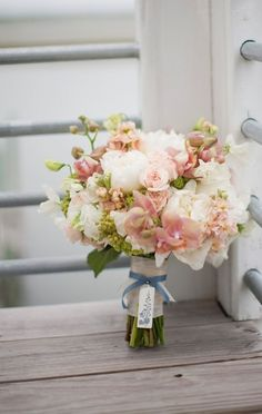 Orchids, peonies, spray roses, hydrangea, viburnum, stock and sweetpea make up this bridal bouquet. Texture