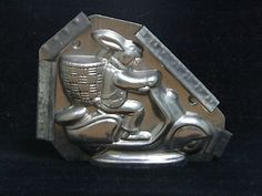 Vintage German Easter candy mold. Rabbit on motorcycle.