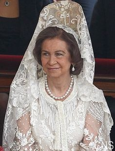 Queen Sofia -- long white dress, white mantilla and pearls --perfection.