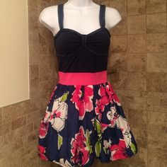HPcute Hollister dress Adorable dress in very good condition. Navy blue cotton top with hot pink elastic waist and lined floral flare skirt with 2 Side pockets. From a smoke free home. Size is small brand is Hollister. ❌NO TRADES❌host pick 3/26 Fashion Faves Hollister Dresses