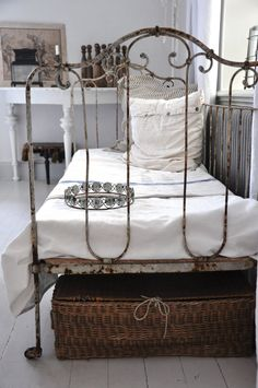 just scored an antique iron crib - one side missing...so, now it's a daybed ;)