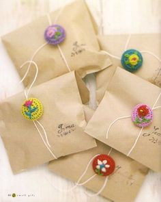 brown paper packages tied up with ... crochet buttons. Idea for a great cookie bag