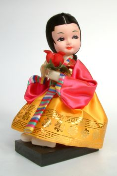Korea | Sitting doll dressed in traditional Hanbok costume