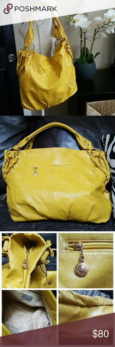 """Philosophy Italy mustard yellow leather purse Gorgeous purse, in great condition ,clean inside and out, very room large purse, you will love it. Aprox 19"""" long 13"""" tall  measured without handles. Philosophy Bags"""