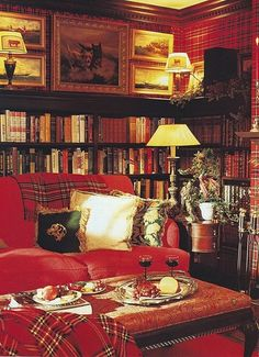 Would love to sit in this room on a cold winter's night.  A warm and inviting library room.  Some type of Plaid or Houndstooth would match Jon's recliner couches.