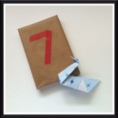 """Sage says, """"On the 7th day of Christmas, my Santa gave to me… an origami swan. And it's a-swimming."""""""