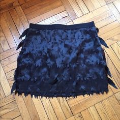 "Romeo & Juliet Couture NWT Fringe Skirt New with tag. Black, modern fringe skirt. 2nd photo shows detail. Zipper back. 15""L waist to hem. Perfect for parties. Skirt is black. Flash went off in 2nd photo due to distance. Skirt is not faded. Romeo & Juliet Couture Skirts"