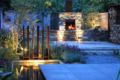 Nice backgarden with fireplave and Cortensteel Waterfeature by Guy Wolfs landscaping