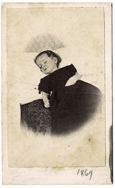 Postmortem toddler, 1869 she has a smile ,so pretty'''with Angels''