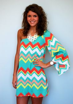 This is the third style in this chevron print. This one shoulder dress will make a statement this spring and summer! Model is 510 and wearing a medium.
