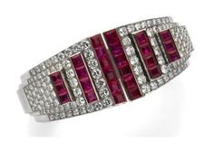 A retro ruby and diamond bangle bracelet, Cartier, circa 1935 the hinged bangle centering step-like terminals of pavé-set round brilliant-cut diamonds and channel-set rubies; signed Cartier, no. 9253; estimated total diamond weight: 7.00 carats; estimated total ruby weight: 11.50 carats; mounted in platinum.