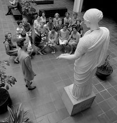 A docent gives a talk in the atrium in Ahmanson building at LACMA, 1964, Photo courtesy Museum Associates-LACMA, Photographic Archives. (This is the site of Tony Smith's iconic sculpture, Smoke, today.)