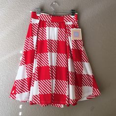 """Lularoe Madison skirt XS Lularoe Madison skirt. Size XS. Very hard to find red plaid/gingham print. Hand box pleats and pockets! 96% spun polyester 4% spandex. Super soft stretchy fabric. 22"""" length. LuLaRoe Skirts"""
