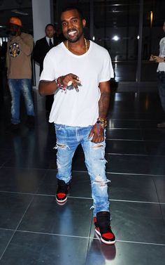 Kanye in ripped stone washed blue jeans with white tee and bred Jordan 1s #Clean&Crisp