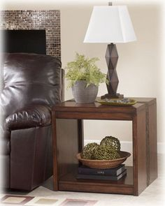 http://smithereensglass.com/rustic-contemporary-medium-brown-table-p-15374.html