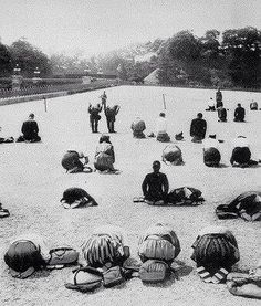 Aug. 15th 1945, Japanese citizens knell in prayer as they hear the news of surrender