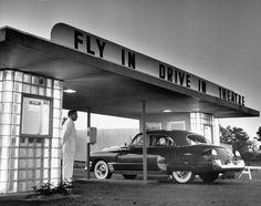 Customers arriving by car at a 'fly-in drive-in' theater, New Jersey, 1949