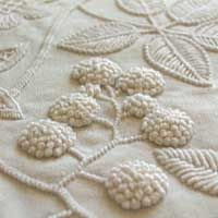 """Mountmellick embroidery featuring blackberry fruit and leaves  inspired by nature  """"Mountmellick embroidery uses floral motifs and heavily knotted and padded stitches. The plants... of Mountmellick...oak, blackberry, dog rose, and ivy.""""  http://www.vettycreations.com.au/me.html#"""