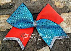 """Sequin turquoise and orange spandex tick tock cheer bow on 3 """" ribbon by Two Tiara's Bowtique on Etsy or Facebook group. Team discounts are always available. Thunder,  OKC, Kevin Durant,  Oklahoma.  Dolphins"""