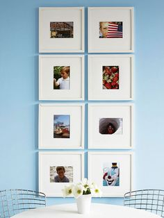 Go all out to fill up boring walls. Hang a grid of favorite pictures or prints inside frames with large mats. The bigger mats will provide much-needed white space for an active display. Onlookers will be able to take in each photo, which makes for an effective display./