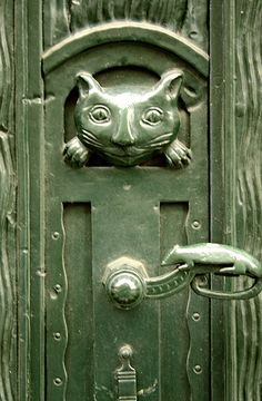 cat door knob - cat and mouse?  Mouse on the handle!