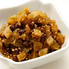 Green Tomato Chutney 1 1/4 pounds green tomatoes, diced 1 cup diced onion 1/2 cup currants 1/3 cup sweet vermouth 2 tablespoons brown sugar 1 tablespoon cider vinegar 2 teaspoons mustard seeds 1/2 teaspoon salt Combine tomatoes, onion, currants, vermouth, sugar, vinegar, mustard seeds and salt in a large saucepan. Bring to a boil, cover, reduce heat and simmer until tender, 30 to 40 minutes.