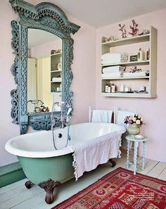 Eclectic bathroom with a bitchin' mirror.