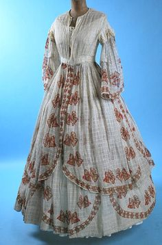 Nice sheer. Anyone guess the date on this? The sleeves say 1850s, and the skirt says late/mid 1860s.