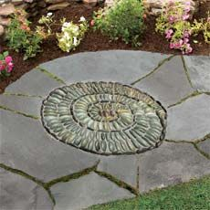 How to Make a Pebble Mosaic  Turn smooth, flat stones into a whimsical outdoor accent of your own design