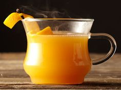 Holiday Hot  Toddy Recipe - Discover how to make this fantastic winter cocktail recipe. Simply Orange, Simply Apple, rum, whiskey, all of the essentials for one delicious hot toddy.