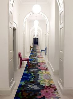narrow and very long corridor, with white walls and several white doors, lit rou. House Design, Stair Runner Carpet, Hallway Walls, Entry Hallway, Hotel Carpet, Trending Decor, Hotel Corridor, Corridor Design, Stairs