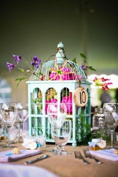 Birdcage centerpiece w/ hanging table number....instead of blue could use mint to paint cage