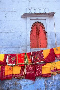 marigold, plum and red on the laundry line