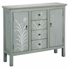 """Hand-painted chest with floral motif.    Product: Chest    Construction Material: Wood    Color: Silver blue   Features:   Gloss floral accents    Hand-painted    Two doors and four drawers   Dimensions: 37"""" H x 42"""" W x 12"""" D"""