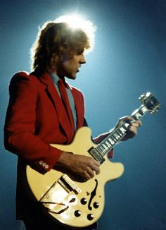 Alex Lifeson of Rush, and the guitar I'll always associate him with--a Gibson ES-335.