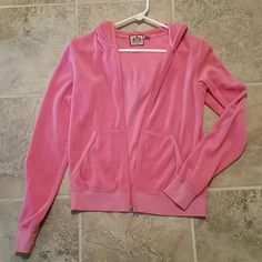 Juicy velour zip up jacket size large pink color Very cute pink colored juicy jacket that says juicy love affair on the back. The large fits more like a medium as juicy does run small. Great condition. No trades, holds, PP, or Merc and reasonable offers via the offer button please. Juicy Couture Jackets & Coats