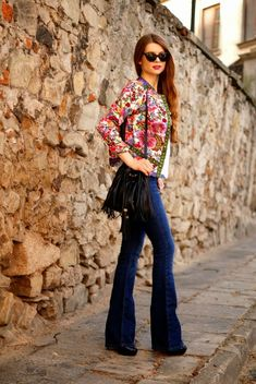 Boho floral jacket, denim flares and fringed shoulder mini bag