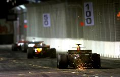 Sparks from Red Bull's Mark Webber at Singapore