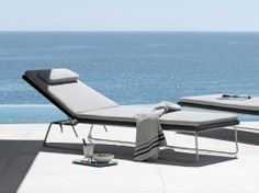 Enjoy spending time outdoors with stylish and durable sun loungers from Cosh Living. Find the right style, colour, and material to match your outdoor terrace or pool area. We offer a wide selection of sun loungers constructed from different materials such as synthetic weave, teak, and powder coated aluminium, with very comfortable and low maintenance Batyline seating. Shop for the perfect sunbeds that will make everyone fall in love with spending time outdoors. We have sophisticated sun…